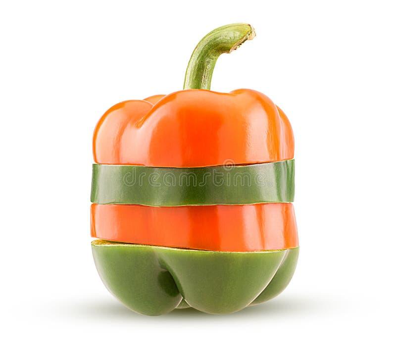 Πράσινα και πορτοκαλιά πιπέρια κουδουνιών φετών στοκ εικόνα με δικαίωμα ελεύθερης χρήσης