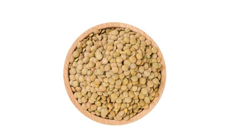 Πράσινες φακές στο ξύλινο κύπελλο που απομονώνεται στο άσπρο υπόβαθρο διατροφή συστατικό τροφίμων στοκ εικόνα με δικαίωμα ελεύθερης χρήσης