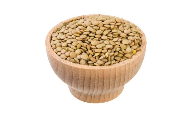 Πράσινες φακές στο ξύλινο κύπελλο που απομονώνεται στο άσπρο υπόβαθρο διατροφή συστατικό τροφίμων στοκ εικόνες με δικαίωμα ελεύθερης χρήσης