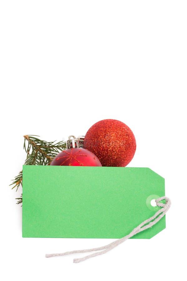 Πράσινη ετικέττα με τις διακοσμήσεις Χριστουγέννων στοκ εικόνες με δικαίωμα ελεύθερης χρήσης