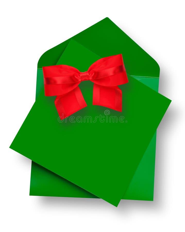 Πράσινη κάρτα και φάκελος με το κόκκινο τόξο στοκ εικόνες