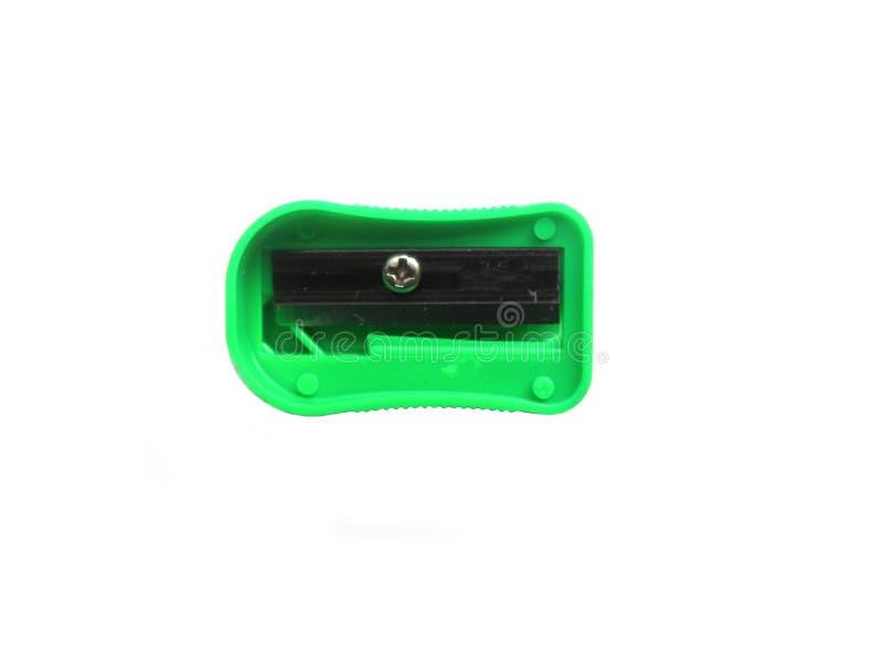 Πράσινη ξύστρα για μολύβια χρώματος στο άσπρο υπόβαθρο στοκ φωτογραφία