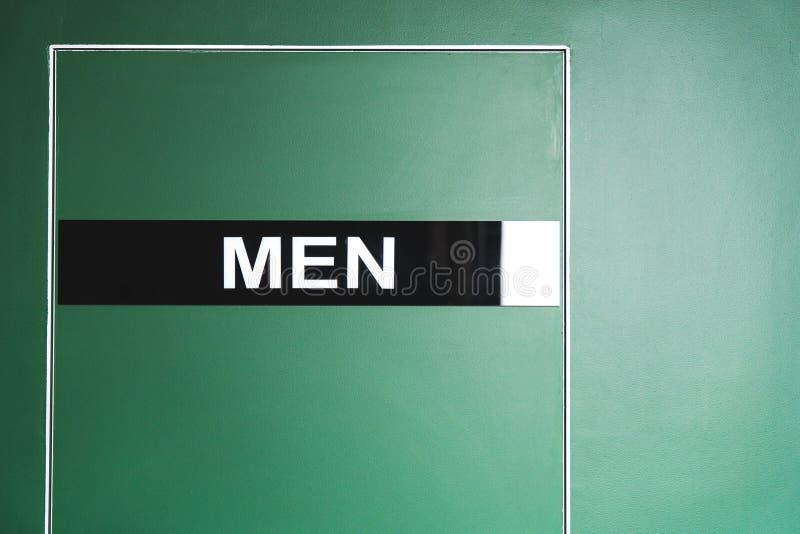 Πράσινη πόρτα στην τουαλέτα με την επιγραφή ενός ατόμου στοκ φωτογραφία με δικαίωμα ελεύθερης χρήσης