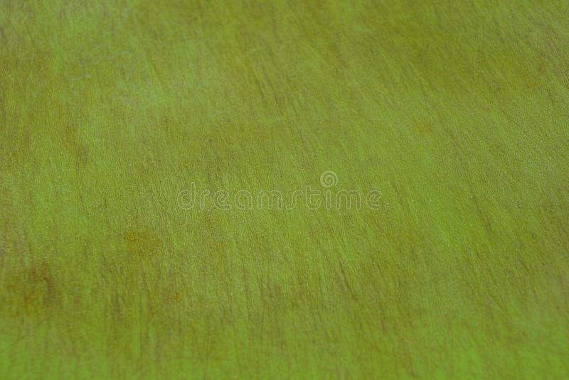 Πράσινη σύσταση ενός κομματιού του ξύλινου πλεγμένου πίνακα στοκ φωτογραφία