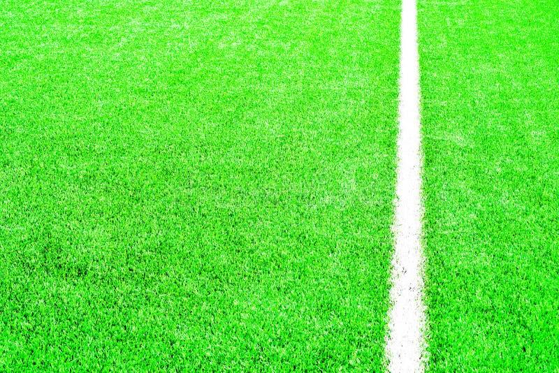 πράσινη σύσταση χλόης ποδοσφαίρου πεδίων ανασκόπησης στοκ εικόνες