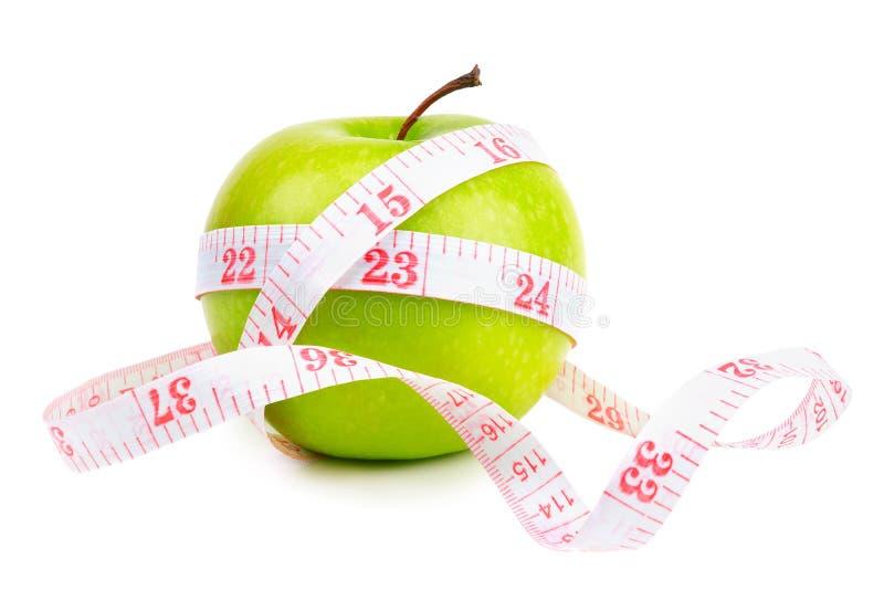Πράσινη ταινία μήλων και μέτρου στοκ φωτογραφία