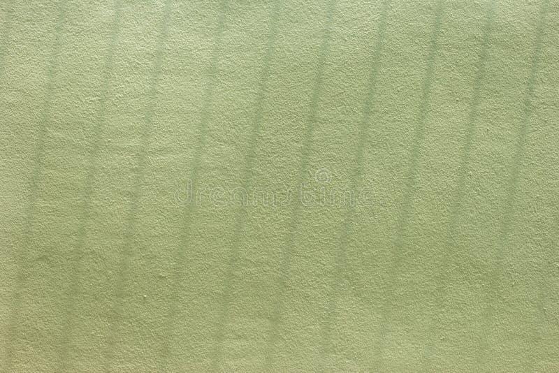 Πράσινη χρωματισμένη επιφάνεια και σκιά τοίχων στοκ εικόνα