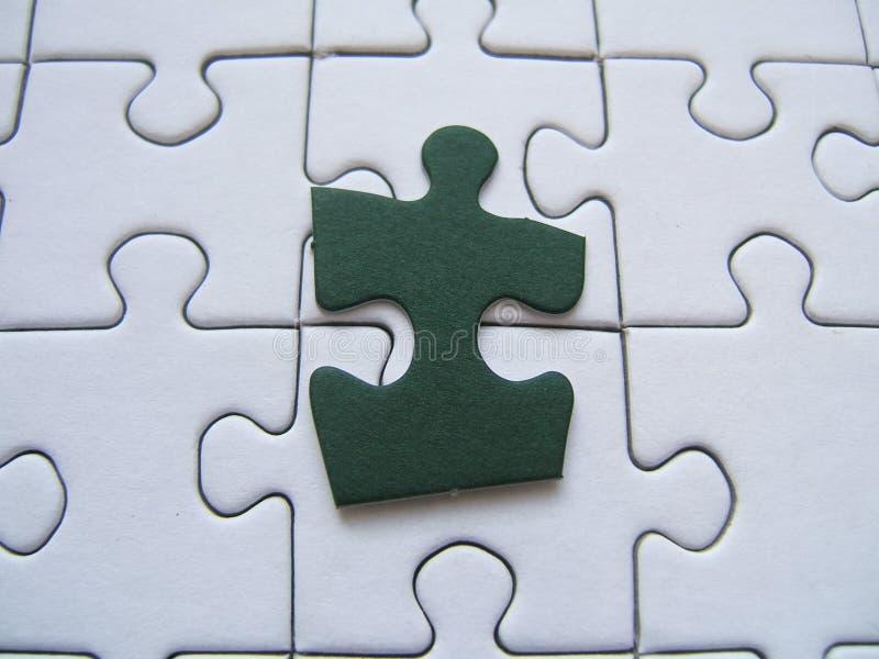 πράσινος γρίφος κομματιού στοκ φωτογραφίες