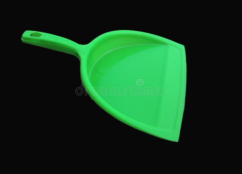 Πράσινος καθαριστής απορριμάτων που απομονώνεται στο μαύρο υπόβαθρο στοκ φωτογραφίες