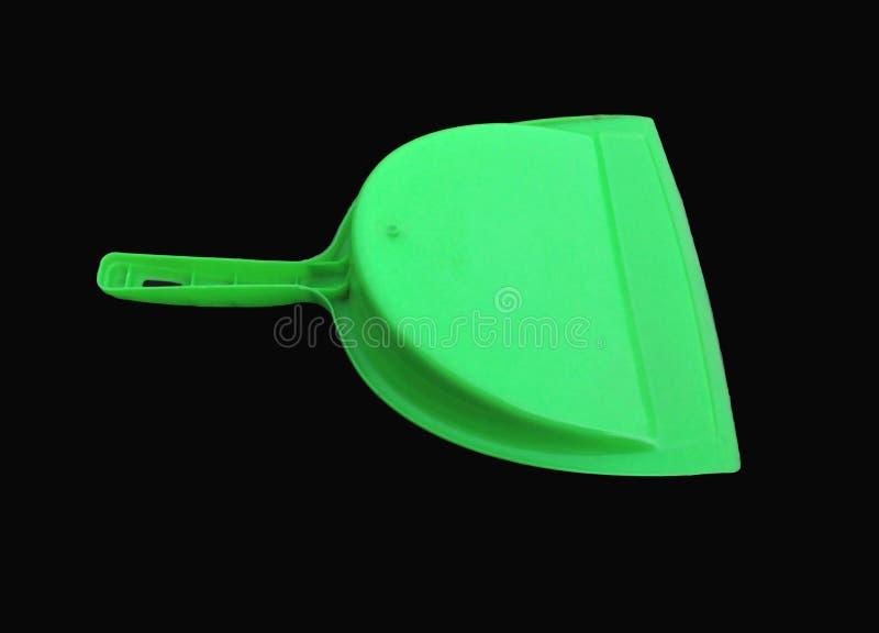 Πράσινος καθαριστής απορριμάτων που απομονώνεται στο μαύρο υπόβαθρο στοκ εικόνες