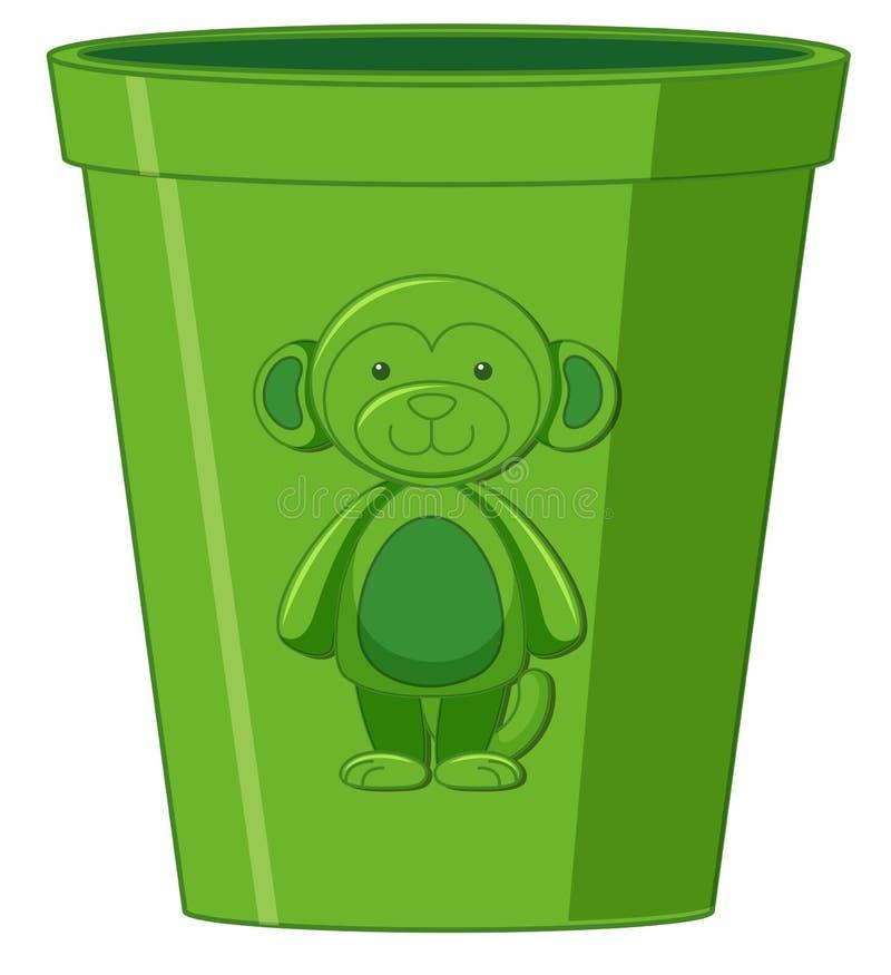Πράσινος πίθηκος σε έναν κάδο απεικόνιση αποθεμάτων