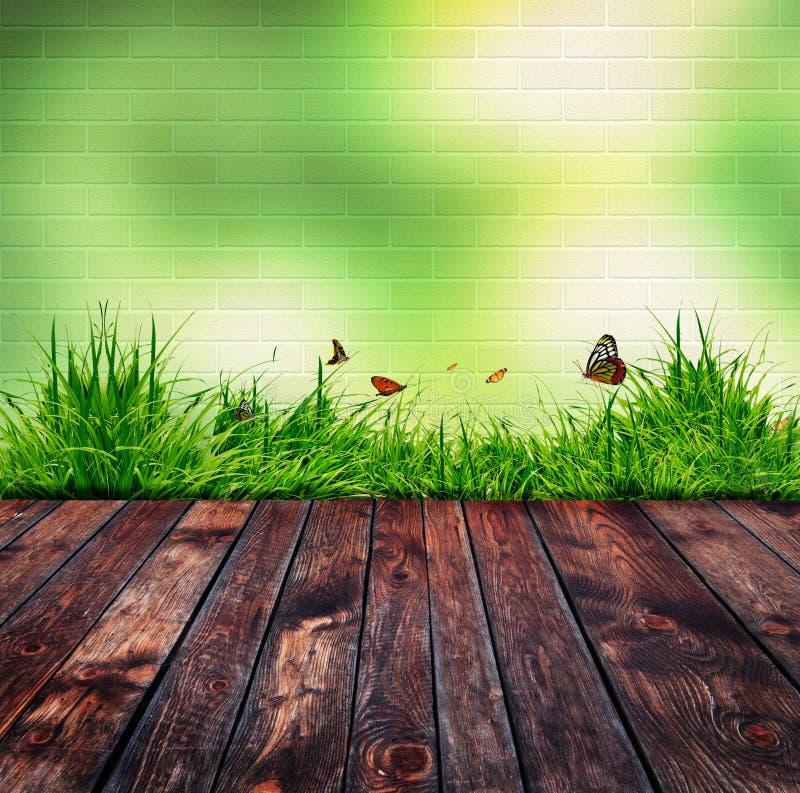 Πράσινος τουβλότοιχος και πράσινη χλόη απεικόνιση αποθεμάτων