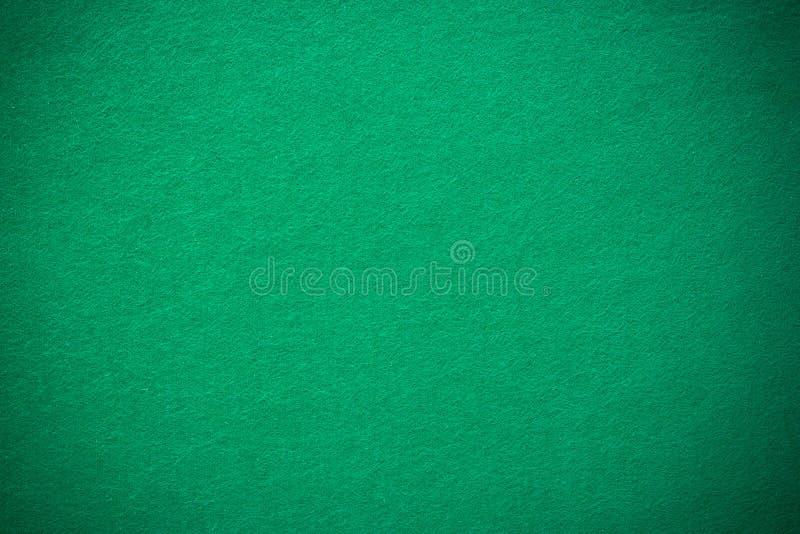 Πράσινο αισθητό χαρτοπαικτική λέσχη ύφασμα πόκερ με το επίκεντρο στοκ εικόνα με δικαίωμα ελεύθερης χρήσης