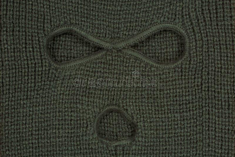 Πράσινο αφηρημένο υπόβαθρο, μια balaclava μάσκα. στοκ εικόνα