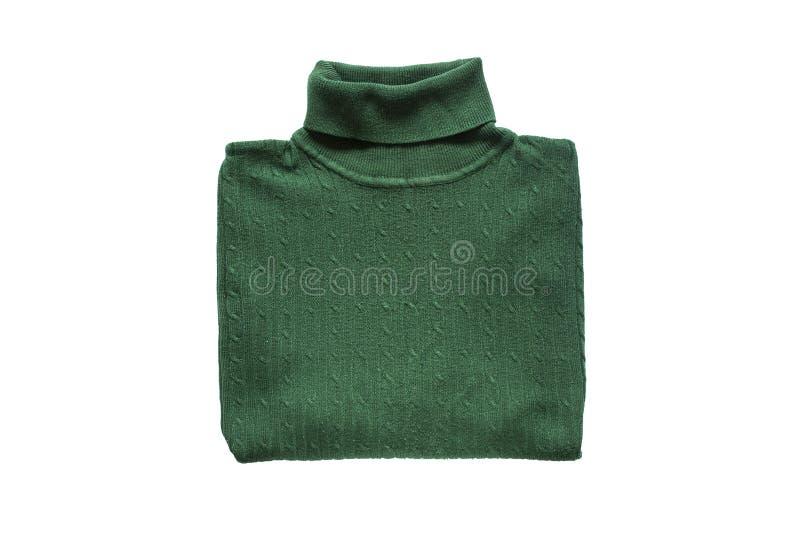 Πράσινο διπλωμένο πουλόβερ στοκ φωτογραφία
