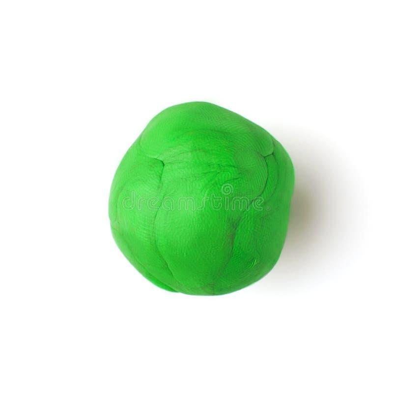 Πράσινο κομμάτι του πλαστικού σε ένα άσπρο υπόβαθρο στοκ φωτογραφίες