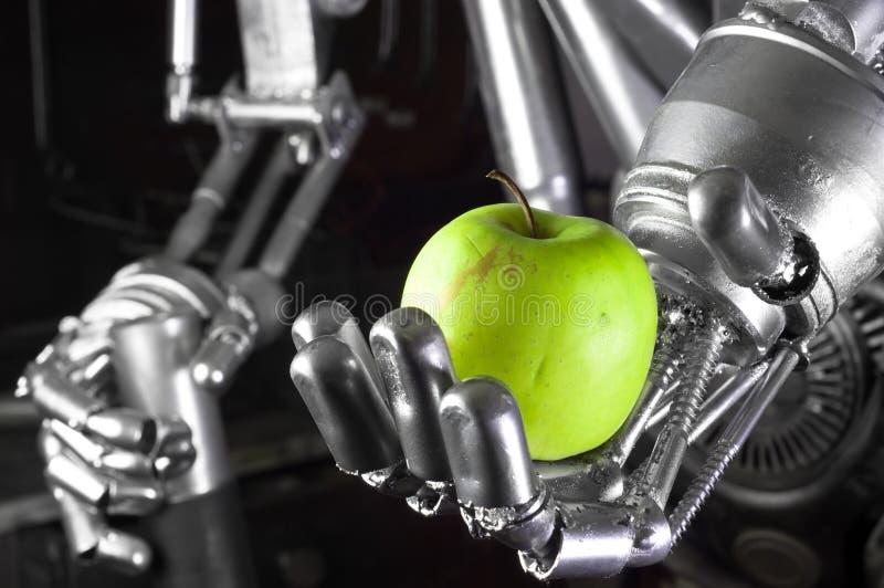 πράσινο μήλου ρομπότ εκμετάλλευσης χεριών στοκ εικόνα με δικαίωμα ελεύθερης χρήσης