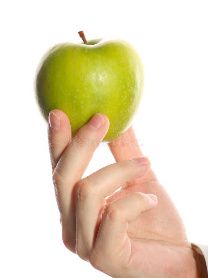 πράσινο μήλου χέρι στοκ εικόνες