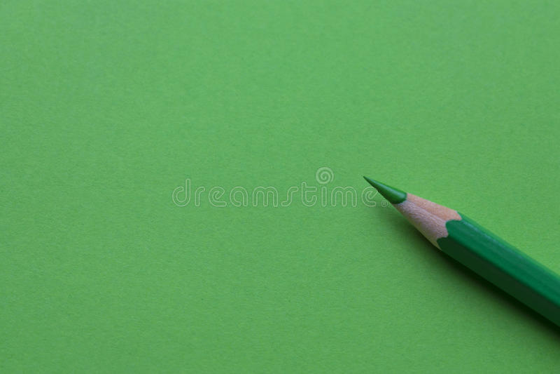 Πράσινο μολύβι στην Πράσινη Βίβλο στοκ εικόνες