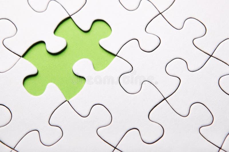 Πράσινο να λείψει κομματιού γρίφων στοκ εικόνα με δικαίωμα ελεύθερης χρήσης