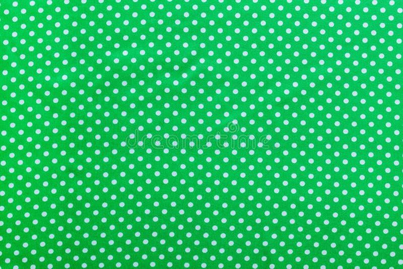 Πράσινο σκηνικό βαμβακιού Πόλκα-σημείων άμεσα ανωτέρω στοκ φωτογραφίες