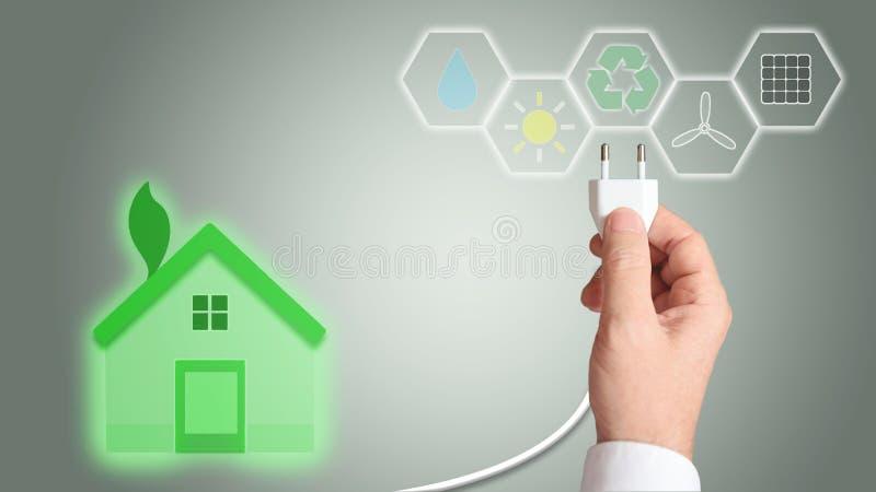 Πράσινο σπίτι ως σύμβολο της ανανεώσιμης ενέργειας και της αρχιτεκτονικής απεικόνιση αποθεμάτων