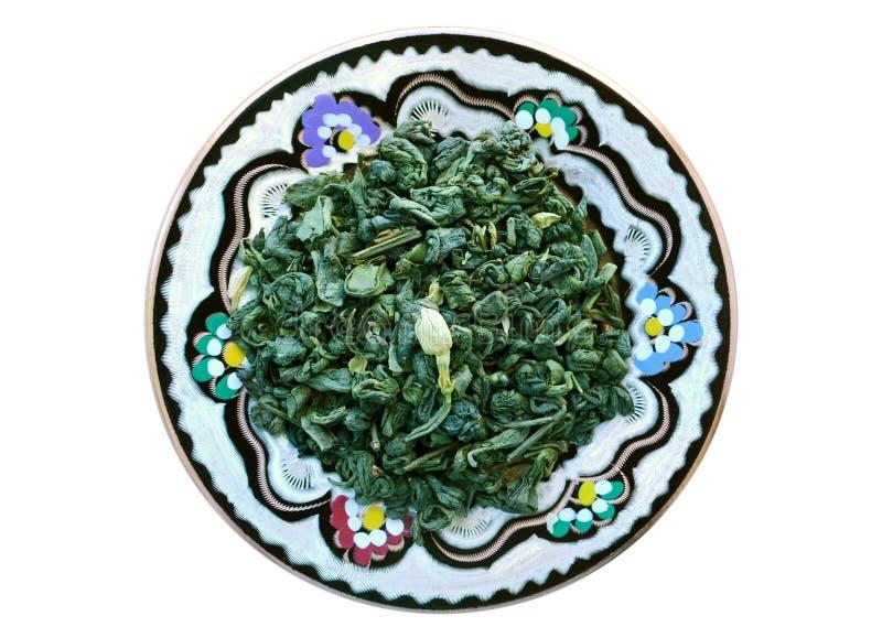Πράσινο τσάι με jasmin στο στρογγυλό πιάτο στοκ εικόνα