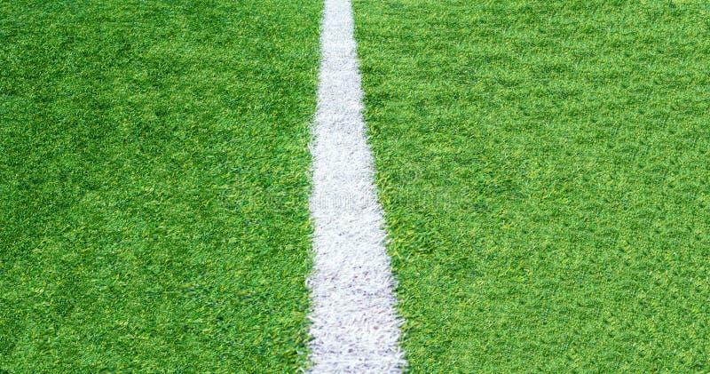 Πράσινο υπόβαθρο γηπέδων ποδοσφαίρου χλόης, τοπ άποψη κινηματογραφήσεων σε πρώτο πλάνο στοκ φωτογραφία με δικαίωμα ελεύθερης χρήσης