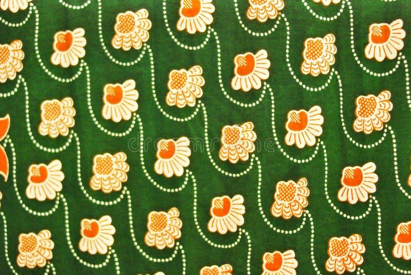 Πράσινο υφαντικό υπόβαθρο σύστασης με τα σχέδια λουλουδιών στοκ εικόνα