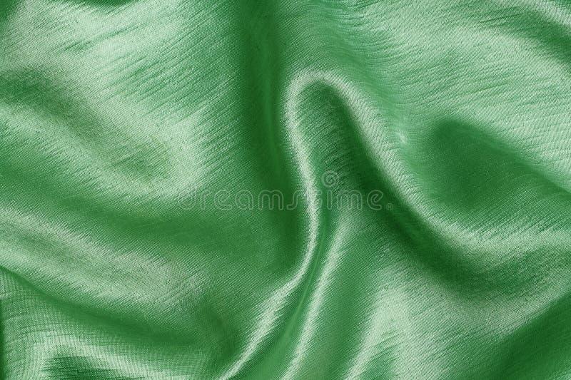 Πράσινο υλικό, ένα υπόβαθρο στοκ φωτογραφία