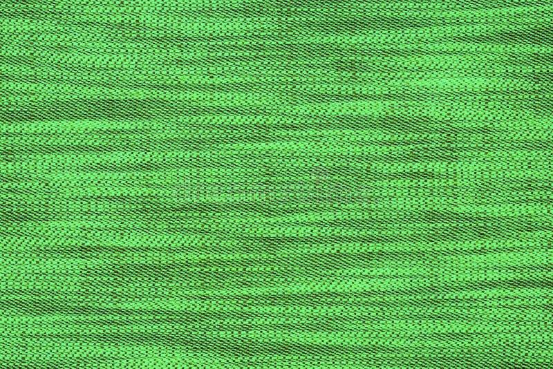 Πράσινο υλικό με το αφηρημένο σχέδιο, ένα υπόβαθρο στοκ εικόνα με δικαίωμα ελεύθερης χρήσης