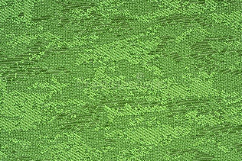 Πράσινο υλικό με το αφηρημένο σχέδιο, ένα υπόβαθρο στοκ φωτογραφία με δικαίωμα ελεύθερης χρήσης