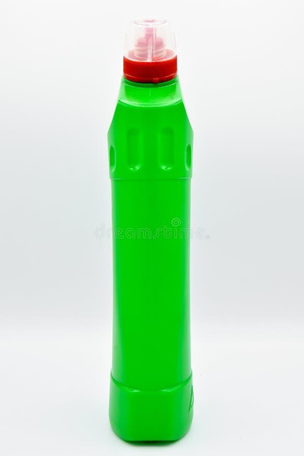 Πράσινο χρωματισμένο πλαστικό καθαριστικό μπουκάλι Καλλυντικό, εμπορευματοκιβώτιο στοκ φωτογραφίες