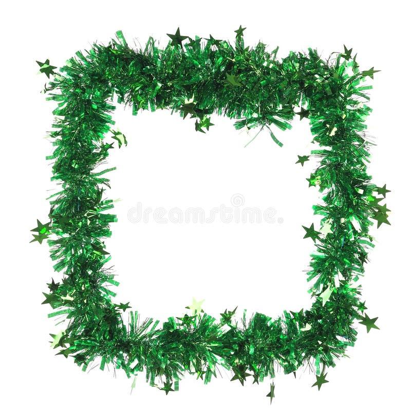 Πράσινο tinsel ως πλαίσιο. στοκ εικόνες