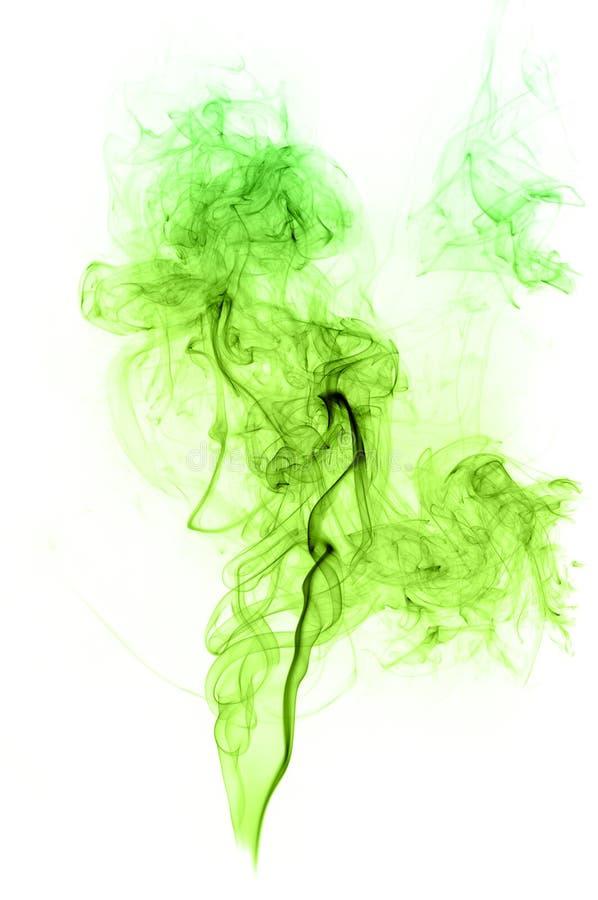 Πραγματικός πράσινος καπνός στο άσπρο υπόβαθρο στοκ φωτογραφίες