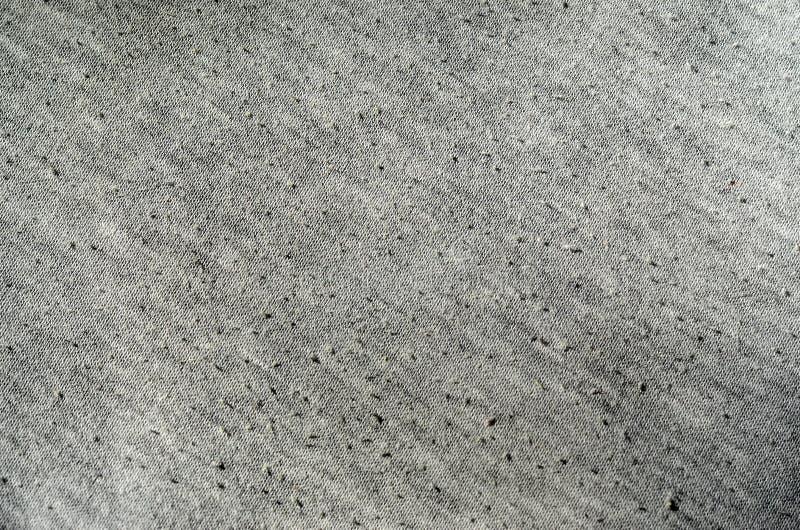 Πραγματικό γκρίζο πλεκτό ύφασμα ερείκης φιαγμένο από συνθετικό κατασκευασμένο backgroun ινών στοκ εικόνες με δικαίωμα ελεύθερης χρήσης