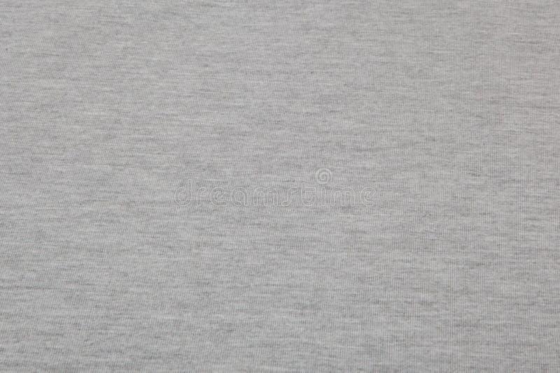 Πραγματικό γκρίζο πλεκτό ύφασμα ερείκης φιαγμένο από συνθετικό κατασκευασμένο υπόβαθρο ινών στοκ εικόνα