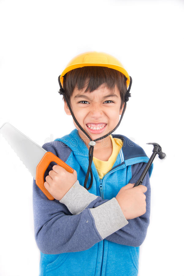 Πρακτικό αγόρι με τα εργαλεία και το σκληρό καπέλο στοκ φωτογραφίες με δικαίωμα ελεύθερης χρήσης