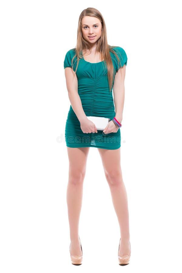 Προκλητική ξανθή γυναίκα με το smartphone στοκ εικόνες