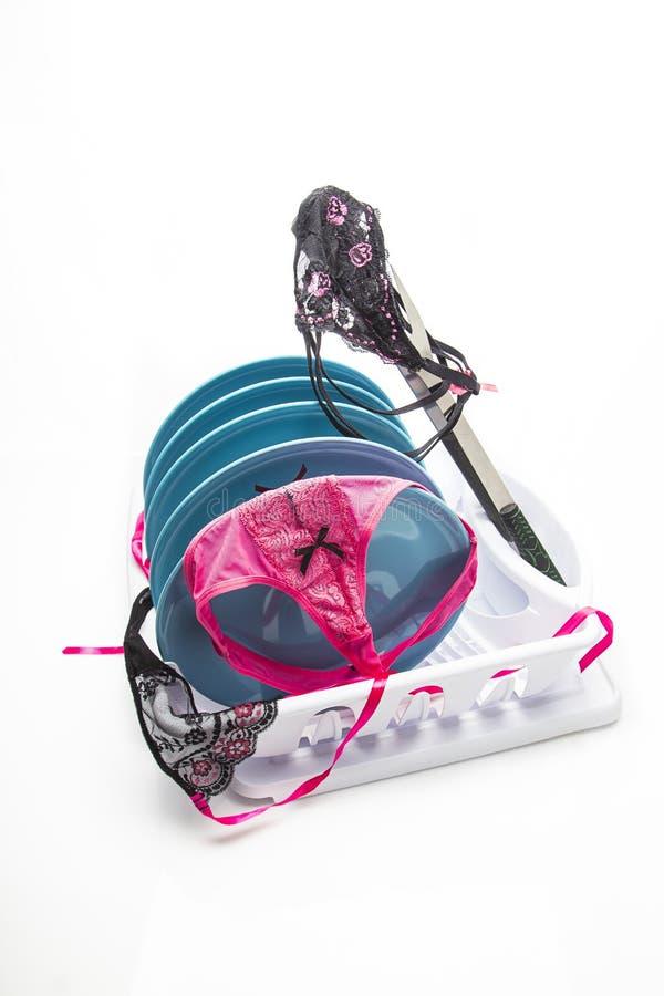 Προκλητικό lingerie και πιάτα στοκ φωτογραφία