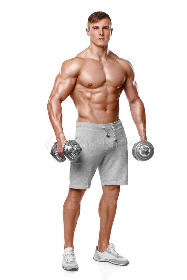 Προκλητικό αθλητικό άτομο που παρουσιάζει μυϊκό σώμα με τους αλτήρες, πλήρες μήκος, που απομονώνεται πέρα από το άσπρο υπόβαθρο Ι στοκ φωτογραφίες με δικαίωμα ελεύθερης χρήσης