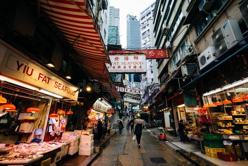 Προμηθευτές τροφίμων στην οδό διαμετρημάτων, στο Χονγκ Κονγκ, Χονγκ Κονγκ στοκ φωτογραφίες