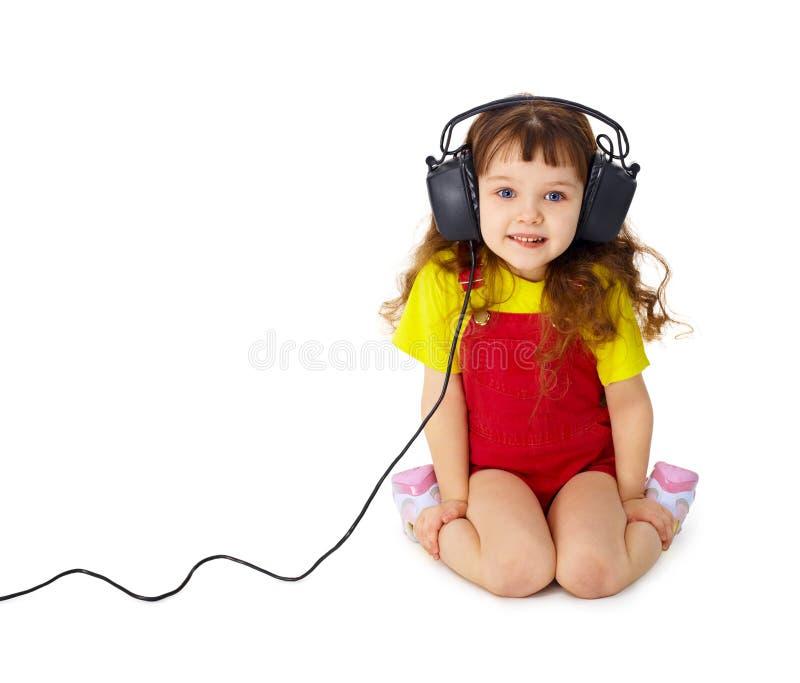 προσεκτικά το παιδί ακού&eps στοκ φωτογραφίες