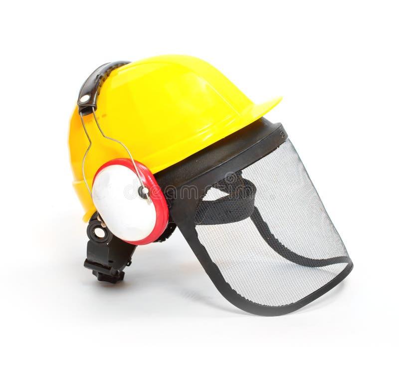 Προστατευτικές κράνος, καλύμματα αυτιών και ασπίδα προσώπου στοκ φωτογραφία