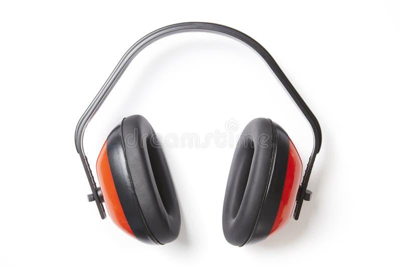 Προστατευτικοί κόκκινοι υπερασπιστές αυτιών στοκ εικόνες