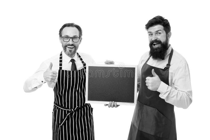 Προσωπικό καφέδων φραγμών i Γενειοφόρο hipster ατόμων που ενημερώνει σας Γενειοφόρος bartender ή μάγειρας ατόμων στο κενό λαβής π στοκ εικόνα με δικαίωμα ελεύθερης χρήσης