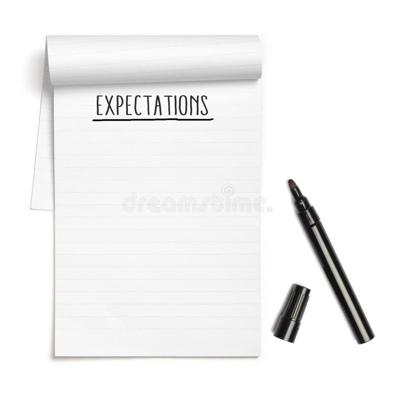 Προσδοκίες στο βιβλίο σημειώσεων με τη μαύρη μάνδρα στοκ εικόνες