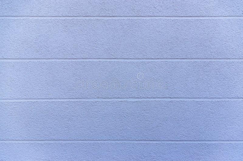 Πρόσοψη λεπτομέρειας ενός σπιτιού με το μπλε ασβεστοκονίαμα και οριζόντια την επέκταση των οπτικών ενώσεων ως στοιχείο σχεδίου ως στοκ εικόνες