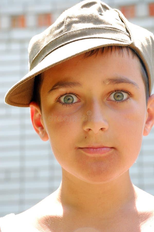 πρόσωπο αγοριών ΚΑΠ στοκ εικόνα με δικαίωμα ελεύθερης χρήσης