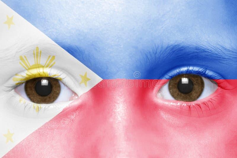 Πρόσωπο με τη σημαία των Φιλιππινών στοκ εικόνες